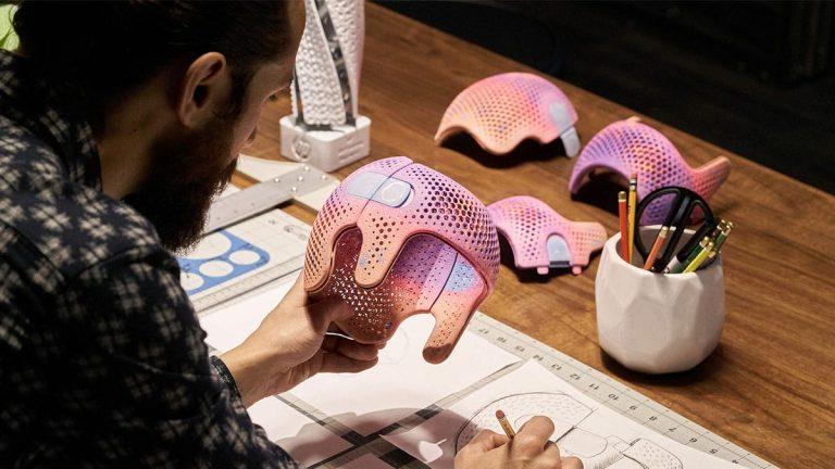 CAD designer with 3D printed part, voxel